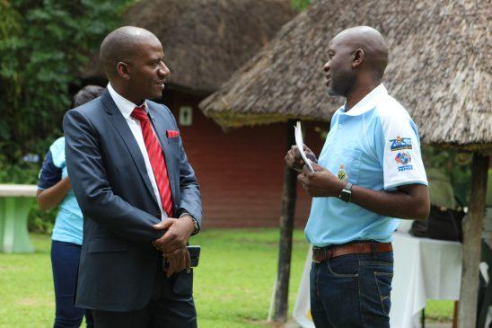 ZIMPHIA Communications (Blue Golf T Shirt) shares a lighter moment with the ZIMPHIA Director Dr Munyaradzi Mapingure