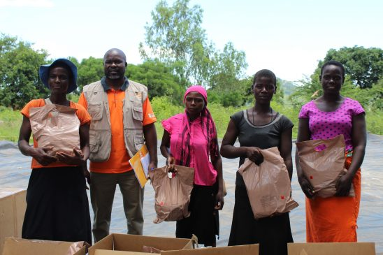 Mr Wilson Muzvondiwa from UNFPA poses for a photo with some of the preganant women who had received the food packages in Rushinga (Pic by Michael Gwarisa)