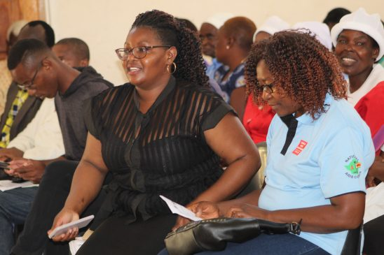 Katswe Sisterhood Programs Officer Otilia Chinyani (Black dress) with National Aids Council (NAC) Official