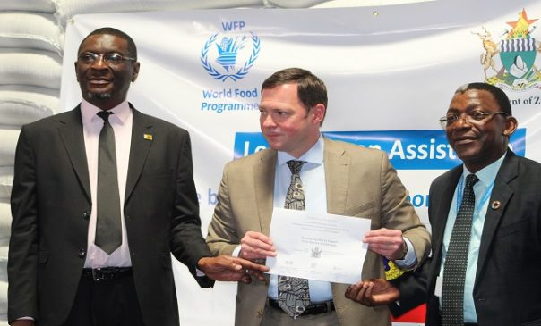 Russian Ambassador (centre) Mr Eddie Rowe (Right) and Mr Erasmus Gapara (left)