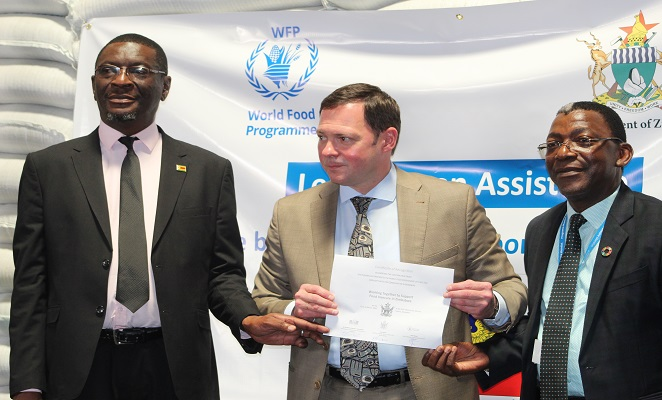 Russian Ambassador (centre) Mr Eddie Rowe (Right) and Mr Erasmus Gapara (left)