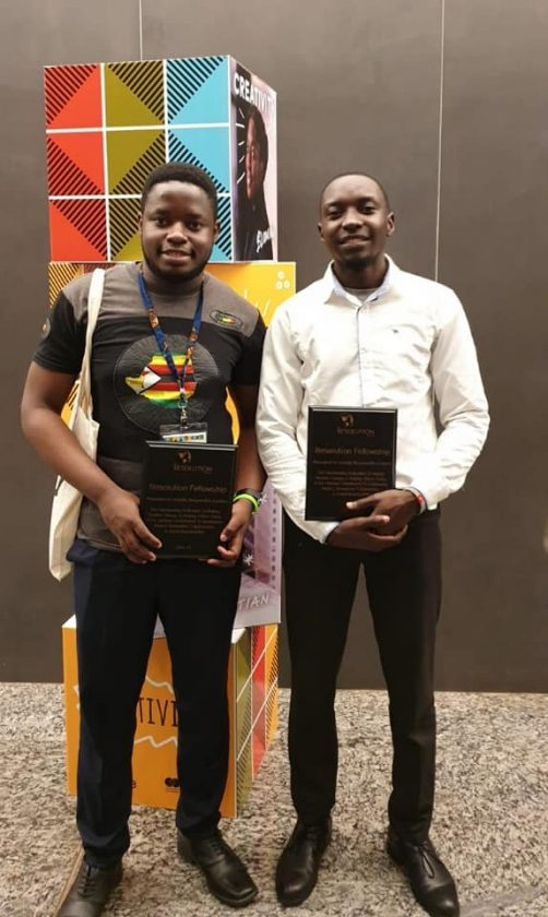 Esau Mhandu and Ronald Tumuhairwe with their Social Venture Challenge awards at the Mastercard Foundation Baobab Summit in Kigali, Rwanda